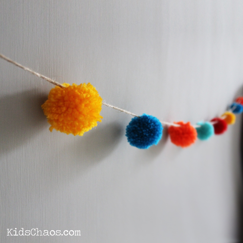 pom pom garland on the wall